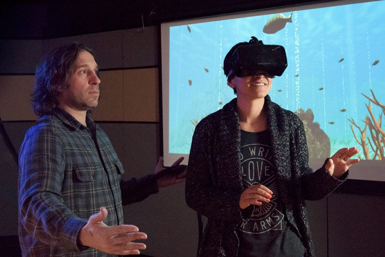 Jeremy Bailenson with student wearing virtual reality headset / L.A. Cicero