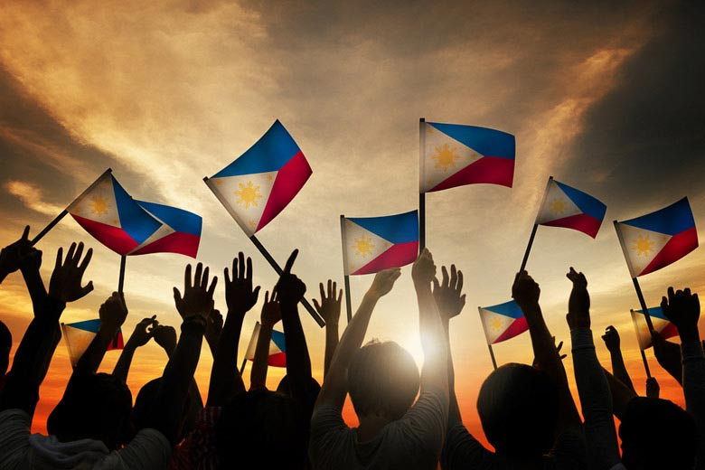 Filipinos waving national flag