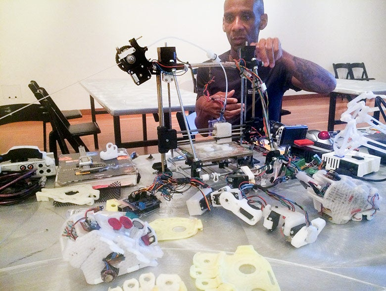 Musician Onyx Ashanti in his workshop creating wearable appendages with which he makes music